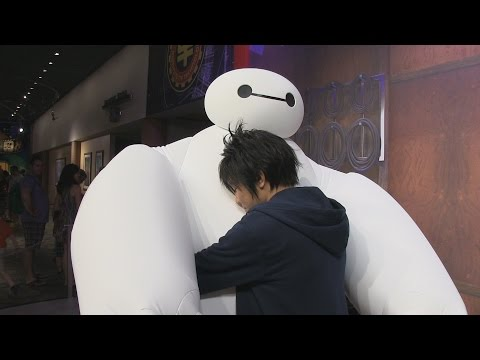 Hiro & Baymax from Big Hero 6 meet guests at Disney's Hollywood Studios