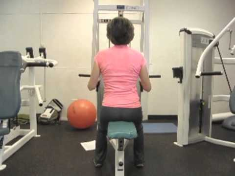 Improve Your Posture with Strength Training: Back Row on a Resistance Exercise Machine Image 1