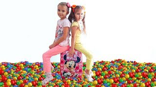 Elina and Julia play with toys and balls