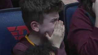 Boy Weeps as College Basketball Team Loses