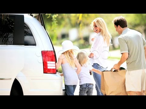 Young Caucasian Family Packing Car Before Outing. Stock Footage