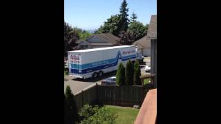 Atlas moving truck pulling into the easement.
