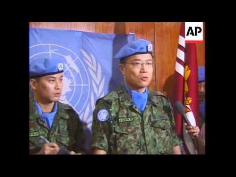 Japanese UN troops arrive and protests over WWII Japanese occupation