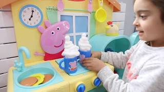 Playing Peppa Pretend Kitchen Set for Childrens