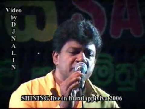 05 Karunarathna Divulgane with Siyinin-2006