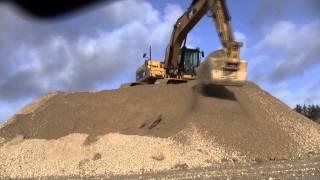 Cat 325D Stockpiling Gravel