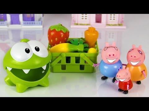 Ам Ням, Свинка Пеппа и папа Свин делят фрукты и овощи.