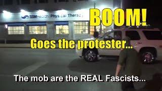 SUV Runs Through Rioters