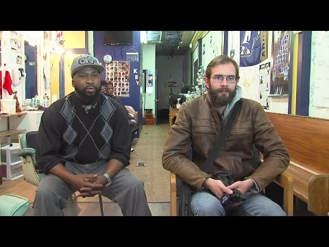 Akron man carrying rifle and pistol confronted by business owner over safety concerns