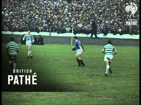 This item is shot in Technicolor. Hampden Park, Glasgow, Scotland. Teams running out on field at start of the Scottish Football Cup final between Glasgow Rangers and Celtics at Hampden...