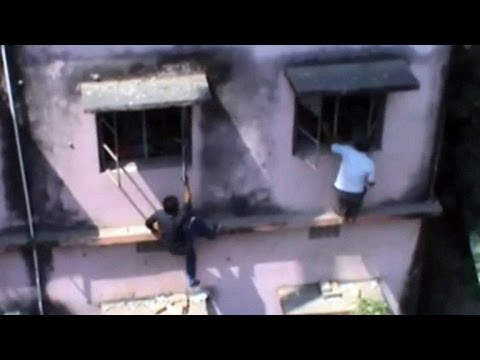 Watch: Indian parents climb school walls to help kids cheat