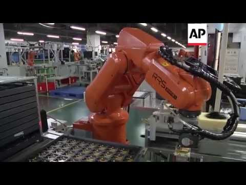 Chinese factory workers being replaced by robots - 2015