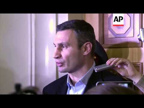 Opposition leader Klitschko and protesters react after PM resigns and govt offers more concessions