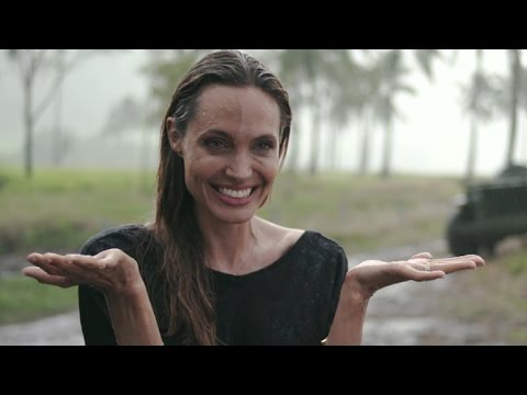 EXCLUSIVE: Angelina Jolie Gets Caught In The Rain Behind The Scenes Of 'Unbroken'