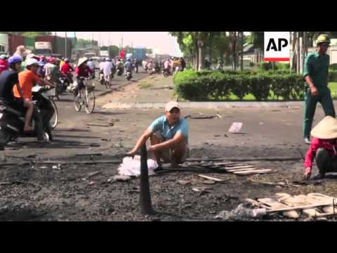 Mobs burned and looted scores of foreign-owned factories in Vietnam following a large protest by wor