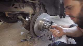 How to install Brake Rotors & Wheel Bearings on Ford Ranger (2008)