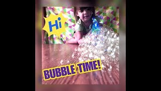 Playing with new bubble shooter inside, outside and in the bathtub! And dance music!