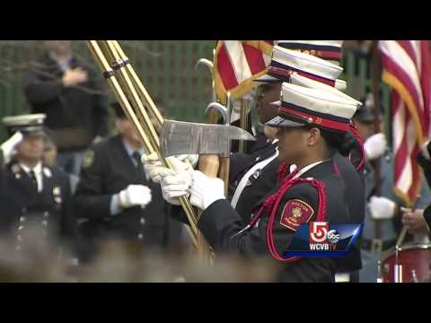 Casket brought to church for firefighter's funeral