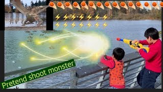 Kids playing at the park, pretend shooting monster in the water