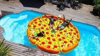 children play with a giant inflatable pizza in Swimming Pool, funny videos for kids