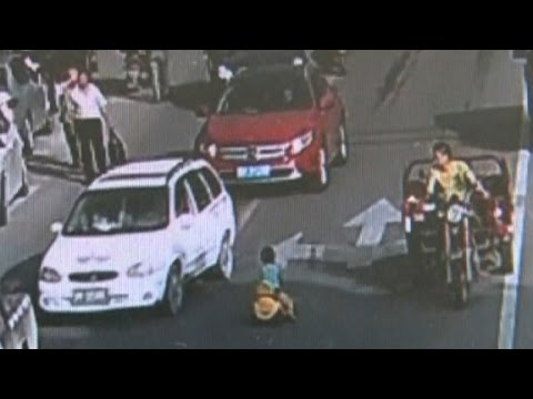 Boy rides toy car into rush hour traffic