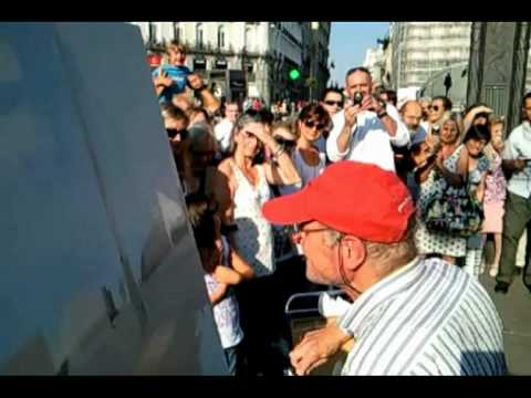 Painting Artist, Antonio Lopez Struggling In Puerta del Sol