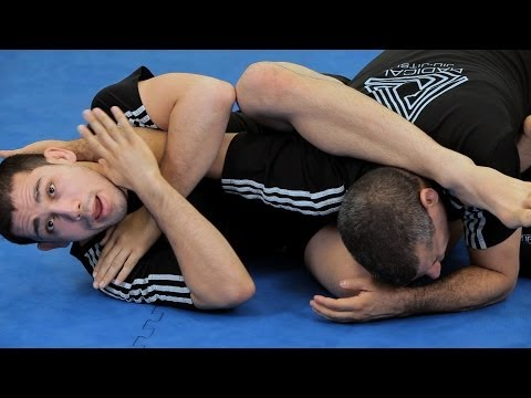 How to Do a Rolling Arm Bar from Guard | MMA Submissions Image 1