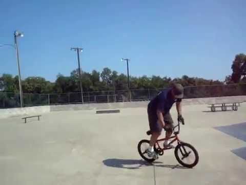 My Dad doing a BMX rollback slide thing!!!!