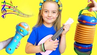 Ulya plays with toy guitar and starts a band