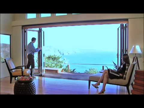 Nanawall glass door on the beach glass wall systems for Glass walls and doors