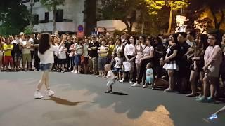 The girl improvises on Pedestrian Street