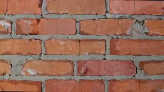 Worker completes a brick wall