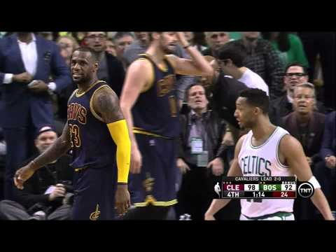 LeBron James blocks Evan Turner at the rim, tells him
