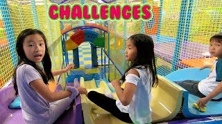 pretend play challenges at an indoor playground fun for kids with giant slides!