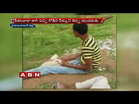 Drunk youth eats live chicken in Telangana | ABN Telugu