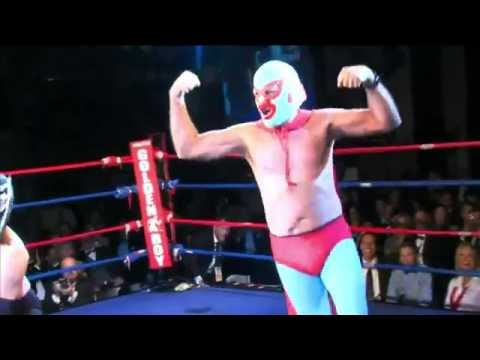 Mitt Romney in a Nacho Libre costume beats up a luchador