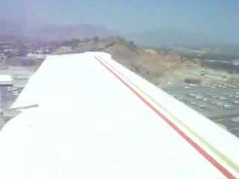 Aborted landing in a F33A when airplane enters runway without clearance. This was at Whiteman Airport in SoCal. Good Go-Around practice.