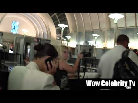 Kim Kardashian rushed through pack of paparazzi at LAX