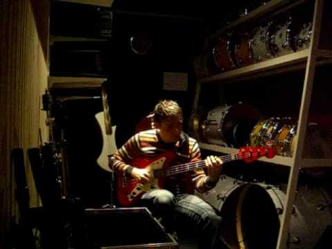 Will Karling plays Jaguar fender bass Hot Rod Red