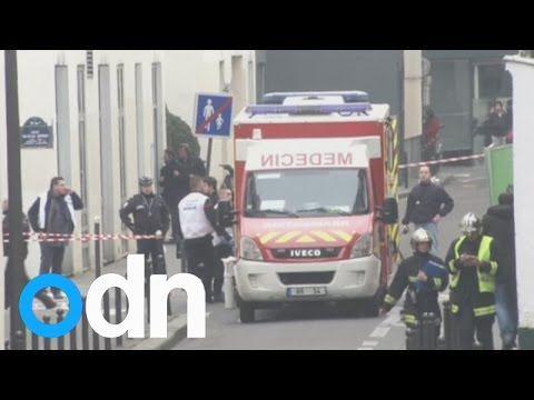 France shooting: 12 dead after gun attack at satirical magazine HQ