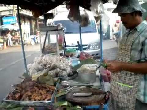 Street Food in Bangkok, Thailand.  Spicy Pork in Banana Leaf.  Sukhumvit Road, Soi 11.