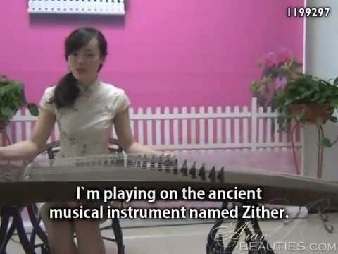 Asianbeauties: Chinese Woman Playing Zither For You. video