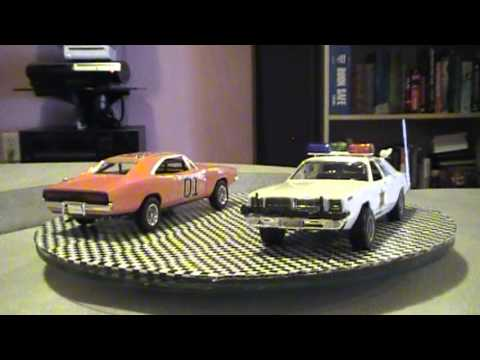 Dukes of Hazzard General Lee and Rosco's Police Car Finished Pre Diorama on Carrosel