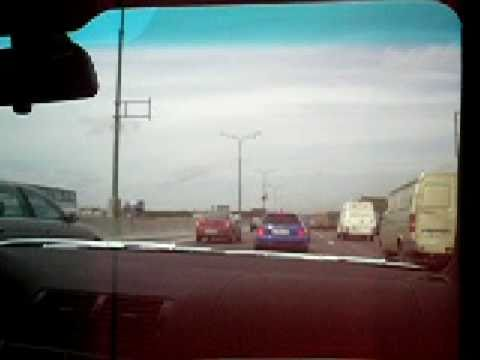 Two import cars racing on the freeway with a lot of traffic - changprice.com more videos