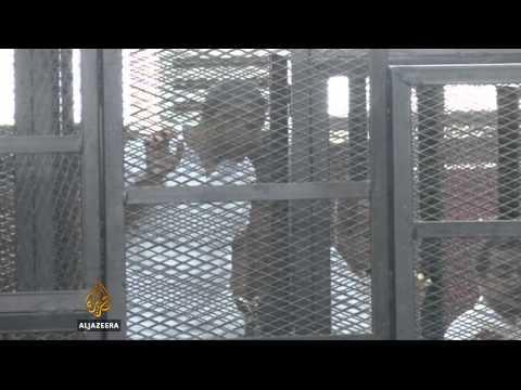 Freed Al Jazeera journalists reunited with family