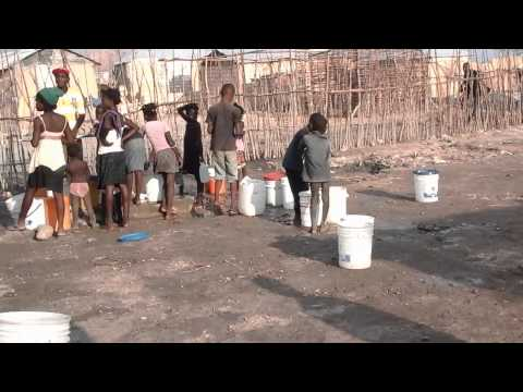 Pumping water in Gonaives, Haiti