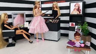 Barbie and little funny daughter doll in a cosmetics store.