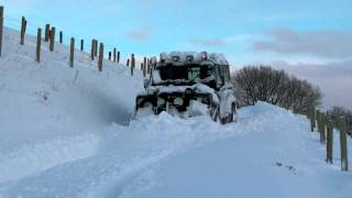 Land Rover ploughing snow