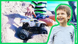 Toy Monster Trucks Play in the Sand