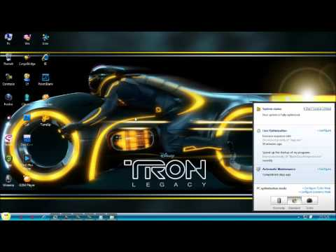 Cara Instal Theme Transparent Versi Tron Legacy...(For Win7)